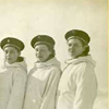 Nine military women in white parkas. click here for full image