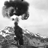 Smoke rising over Dutch Harbor from Japanese bombing. click here for full image